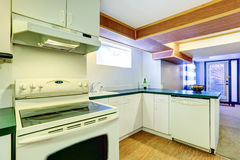 White basement kitchen room with green counter tops Stock Photos