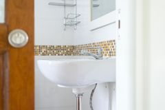 White basin in the bathroom,wash bowl in lavatory or toilet. At home Royalty Free Stock Photos