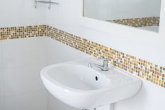 White basin in the bathroom,wash bowl in lavatory or toilet. At home Stock Photo