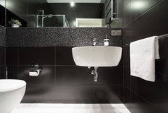 White basin. On black wall in modern bathroom royalty free stock photography