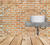 White basin and chrome faucet on brick wall Royalty Free Stock Photography