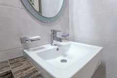White basins in bathroom interior with granitic tiles Royalty Free Stock Image
