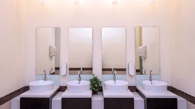 white basins in bathroom interior with granitic tiles Stock Image