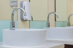 White basins in bathroom interior with granitic tiles Royalty Free Stock Photo