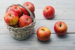 White Basket with Apples Royalty Free Stock Photos