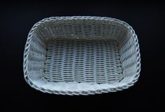 White basket on black background. royalty free stock image