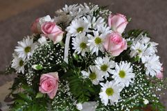 White Basket Of Daisies and Pink Roses Stock Images