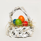 White basket with easter eggs Stock Photos