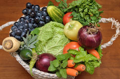 White basket with fresh healthy vegetables and fruit Royalty Free Stock Photography