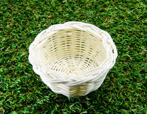 White basket. On grass background Stock Photos