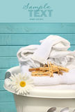 White basket with laundry royalty free stock photography