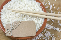 White basmati rice with chopsticks and brown card Stock Image