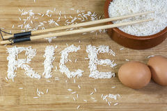 White basmati rice with chopsticks and two brown eggs Royalty Free Stock Photos