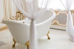 White bath with baldachin next to big window Stock Image