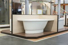 White bath in the building store. baths in the plumbing store. Sanitary engineering shop. White bathrooms. Corner bathtup in the b. Uilding store royalty free stock photography
