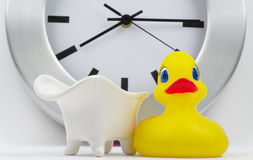 White bath with clock and toy Stock Image