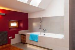 White bath in designed bathroom. White bath in a designed bathroom, horizontal stock image