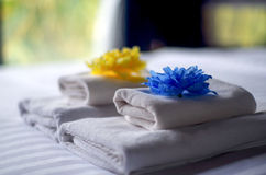 White bath towel on the bed Royalty Free Stock Images