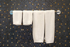 White bath towels on towel rack Stock Photography