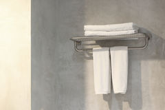 White bath towels on towel rack. In bathroom Royalty Free Stock Photo