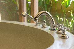 White bath tub with faucet. And beige tiles royalty free stock photography