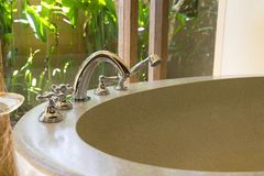 White bath tub with faucet. And beige tiles stock photos