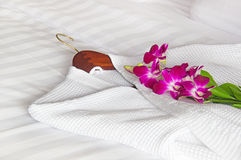White bathrobe on the bed stock images