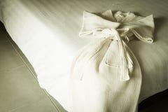 White bathrobe on bed Stock Photography