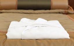 White bathrobe on the hotel bed Stock Image