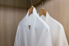 White bathrobes hanging Royalty Free Stock Image