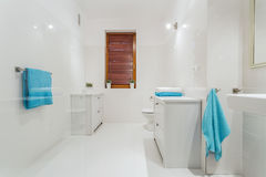White bathroom. Big white bathroom with blue towels royalty free stock photo