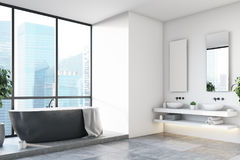 White bathroom, black tub, tree, corner Royalty Free Stock Photography
