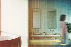 White bathroom, black tub, tree, woman Stock Image
