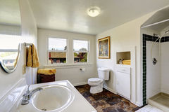 White bathroom with contrast brown tile floor Stock Photos
