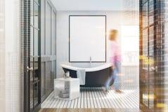 White bathroom, black tub, poster, woman Stock Photos