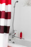 White bathroom with red accents Stock Images