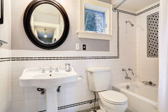 White bathroom with tile wall trim Stock Image