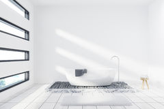 White bathroom with a tub. White bathroom interior with a white tub, a towel hanging on it, a small shelf for self care products and two windows. 3d rendering stock illustration