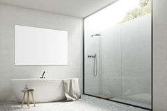 White bathroom with a tub and poster, corner Stock Photos