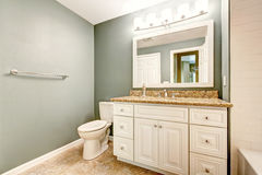 White bathroom vanity cabinet with granite top Stock Images