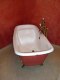 White bathtub. In a red bathroom Stock Image