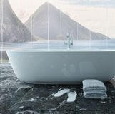 White bathtub in front of floor to ceiling window Stock Image