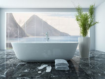 White bathtub in front of floor to ceiling window Royalty Free Stock Photography