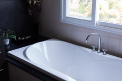 White bathtub in luxury bathroom Royalty Free Stock Image