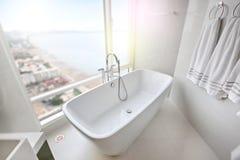 White bathtub in Modern condominium stock photography