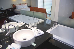 White bathtub and sink in spa hotel Stock Images
