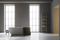 White tub in a gray bathroom with white floor Stock Image