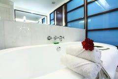 White bathtub with towel Stock Image