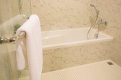 White bathtube. In  a bathroom stock photography