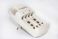 White battery charger Stock Photos